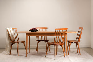 Solid wood Shaker dining table with spindle chairs.