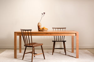 Modern wood Parsons table with finger joints, from Chilton Furniture. Shown with walnut chairs.