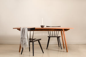 Scandinavian inspired walnut dining table with black wood chairs from Chilton Furniture.