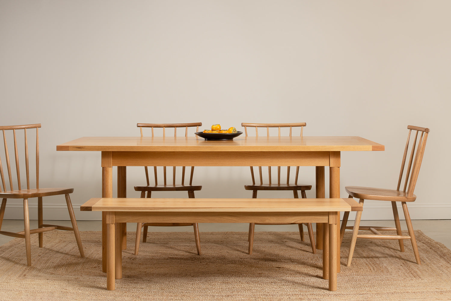 Revelry dining set from Chilton Furniture shown in white oak solid wood with fruit on table