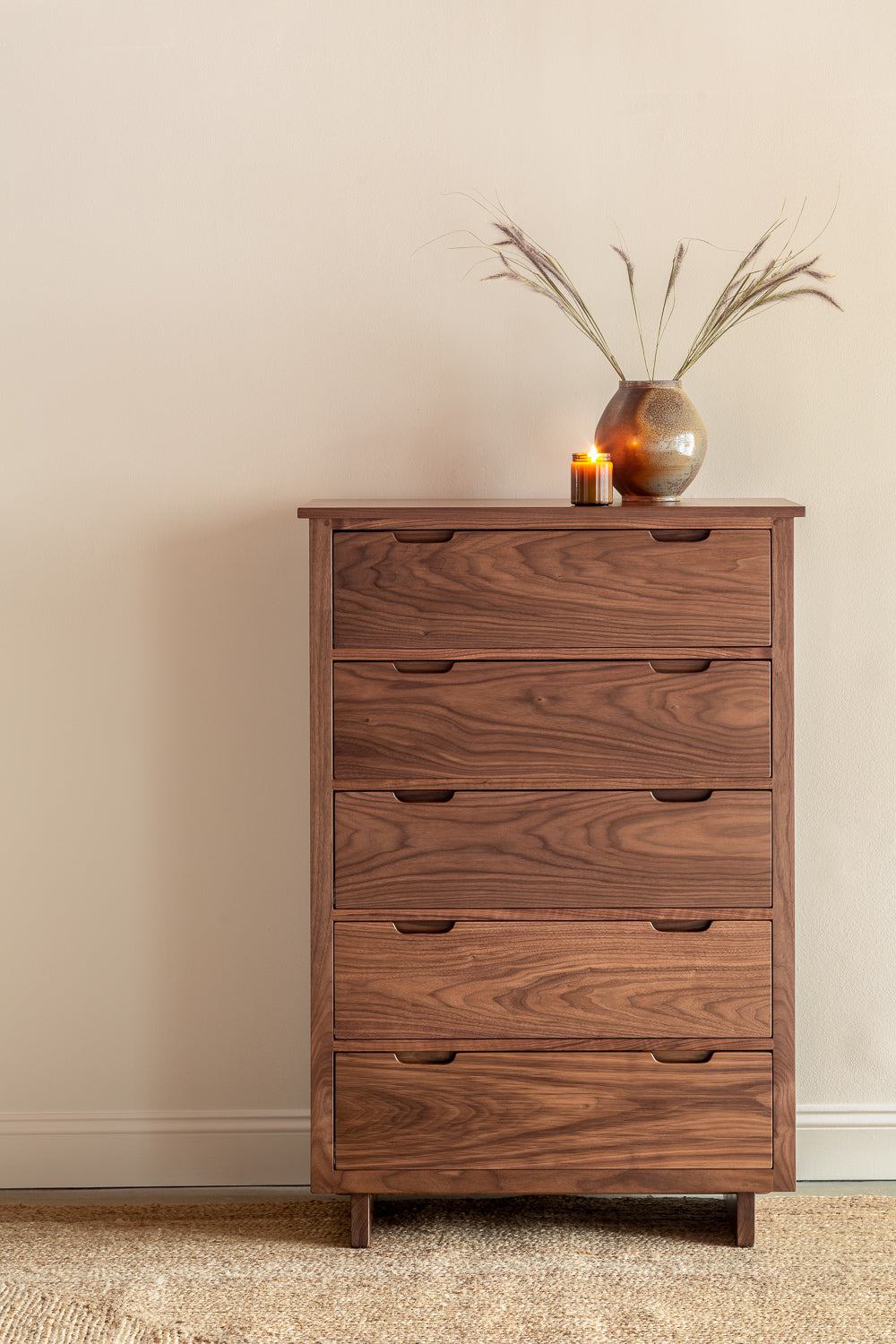 Modern five drawer Foundation Chest in walnut wood with pottery and candle
