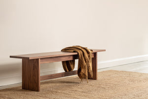 Modern Scandinavian inspired Hygge Bench in walnut with throw blanket