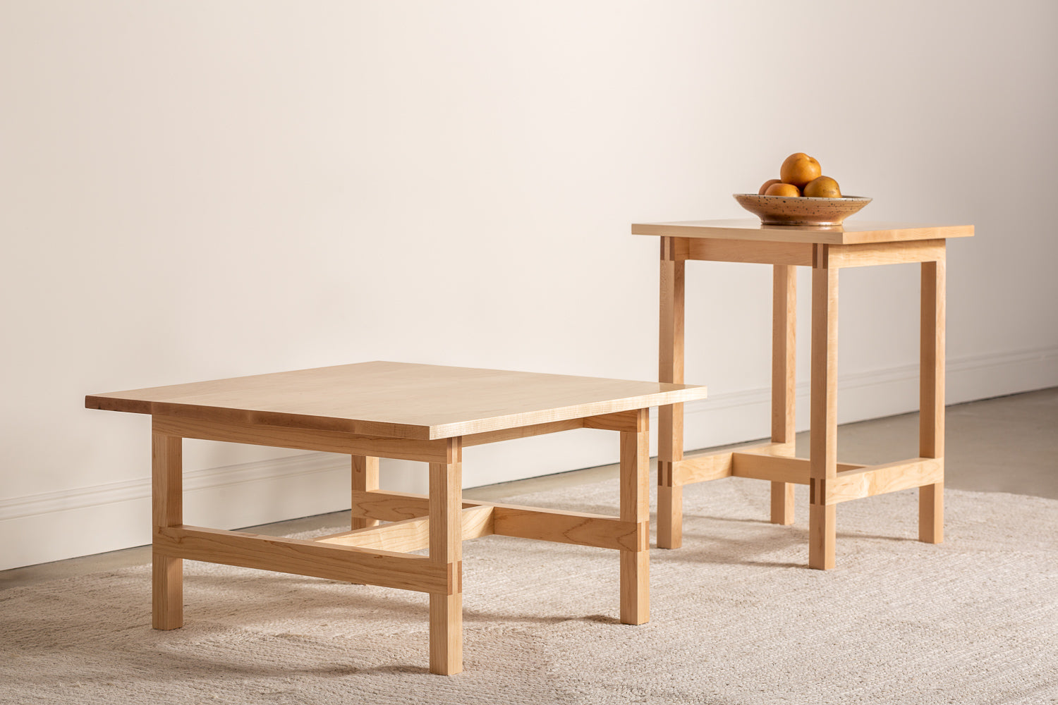 Modern Union Side table and Coffee table shown in maple with bowl of fruit