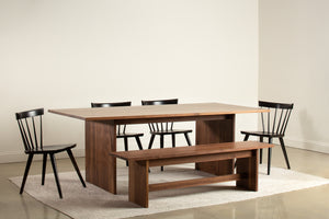 Modern Hygge Dining Table and Bench in walnut with black Windsor inspired Boston Chairs
