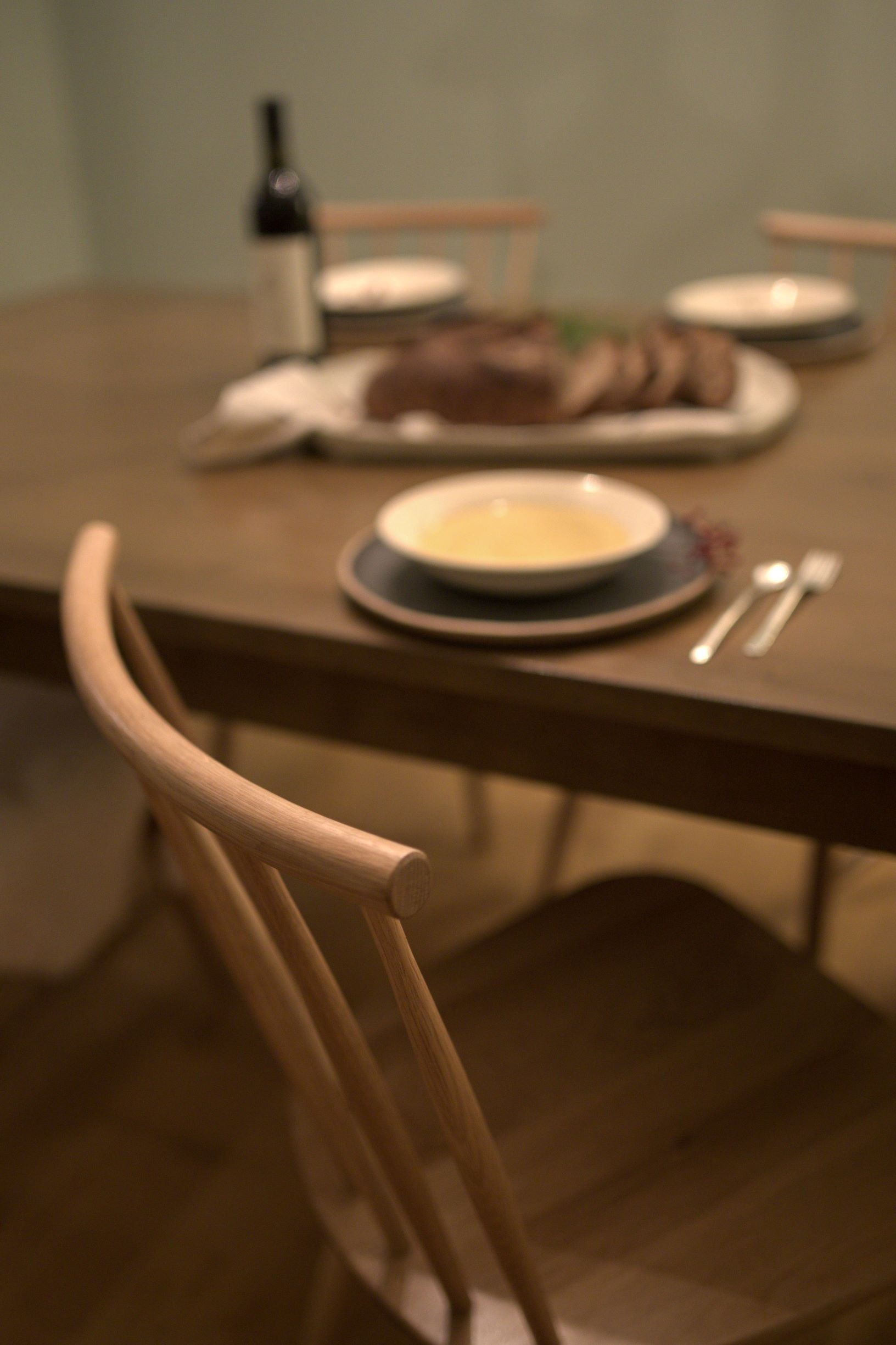 Thanksgiving dinner table setting with white oak spindle Concord chairs