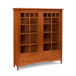 Arts and Crafts style solid cherry double bookcase with arched apron, glass doors and two low drawers