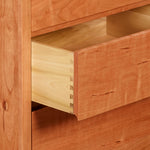 Open drawer of cherry Acadia bedroom storage chest showing dovetail joinery