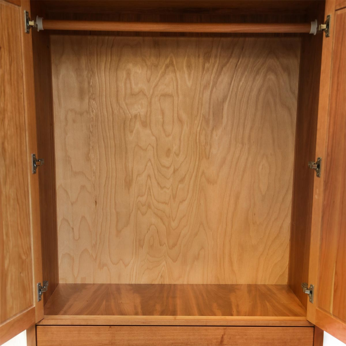 Storage space of classic cherry Shaker wardrobe, from Maine's Chilton Furniture Co.