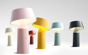 Six staggered Bicoca cordless lamps in white, pink, red, yellow, blue and black