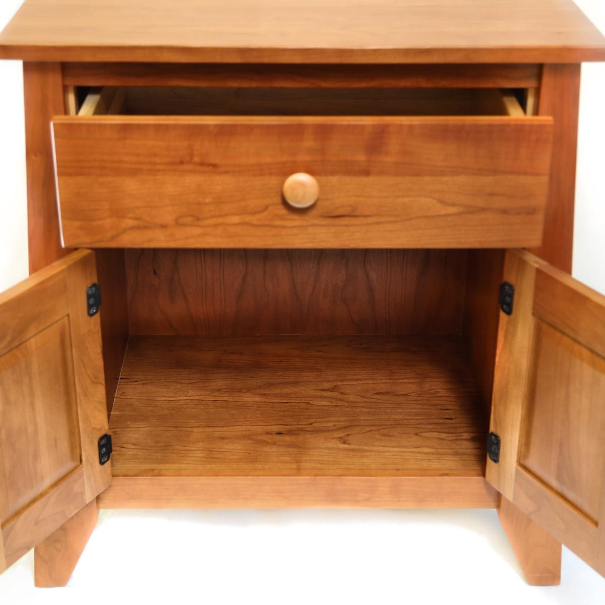 Open doors of solid cherry Bangor nightstand showing storage space