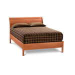 Modern take on Victorian era sleigh bed, with curved headboard, in cherry wood