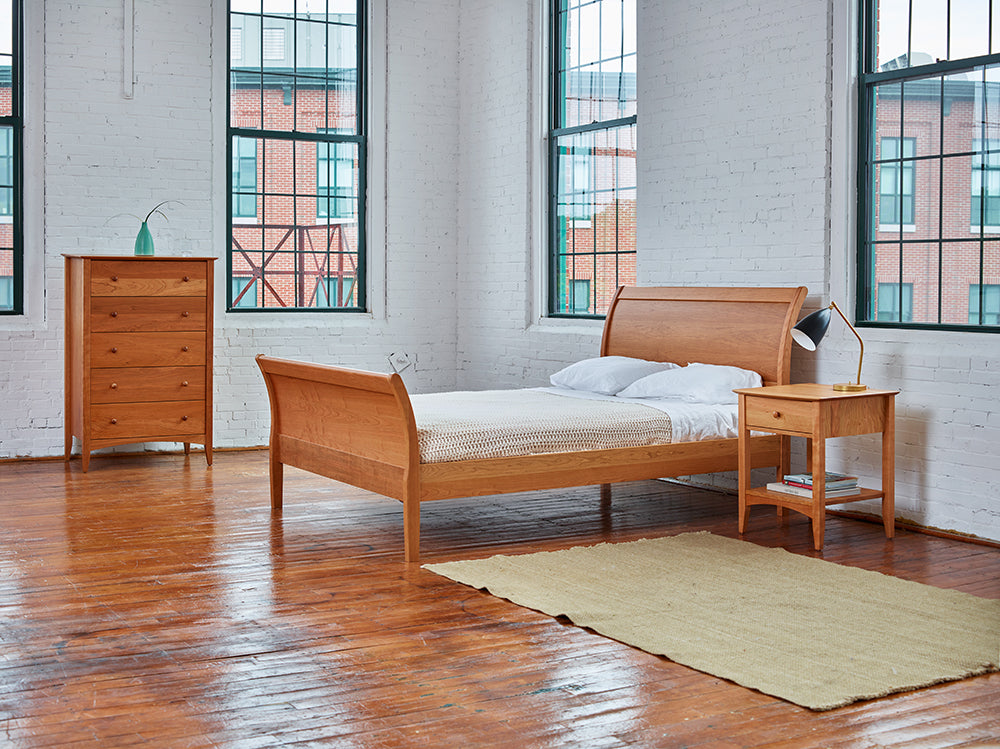 Modern warehouse bedroom styled with Chilton Furniture's cherry wood Shaker inspired Penobscot bedroom collection