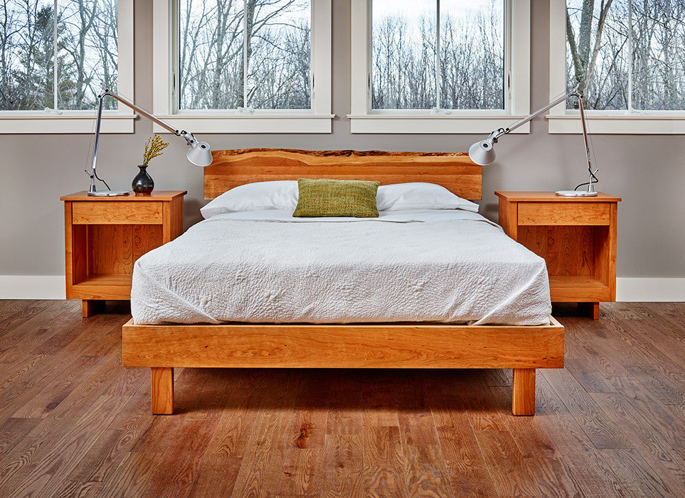 Modern bedroom with two Acadia nightstands and live edge bed in cherry made with white bedding