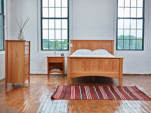 Modern warehouse bedroom styled with Chilton Furniture's cherry wood Bethel bedroom collection