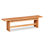 Bench with panel style trestle legs built in cherry wood.
