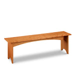 Simple cherry wood bench, built in the Shaker style with half-moon cutout on both leg boards from Maine's Chilton Furniture Co.