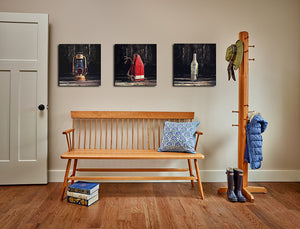 Mudroom styled with solid cherry wood Shaker bench and coat rack and nautical themed photos