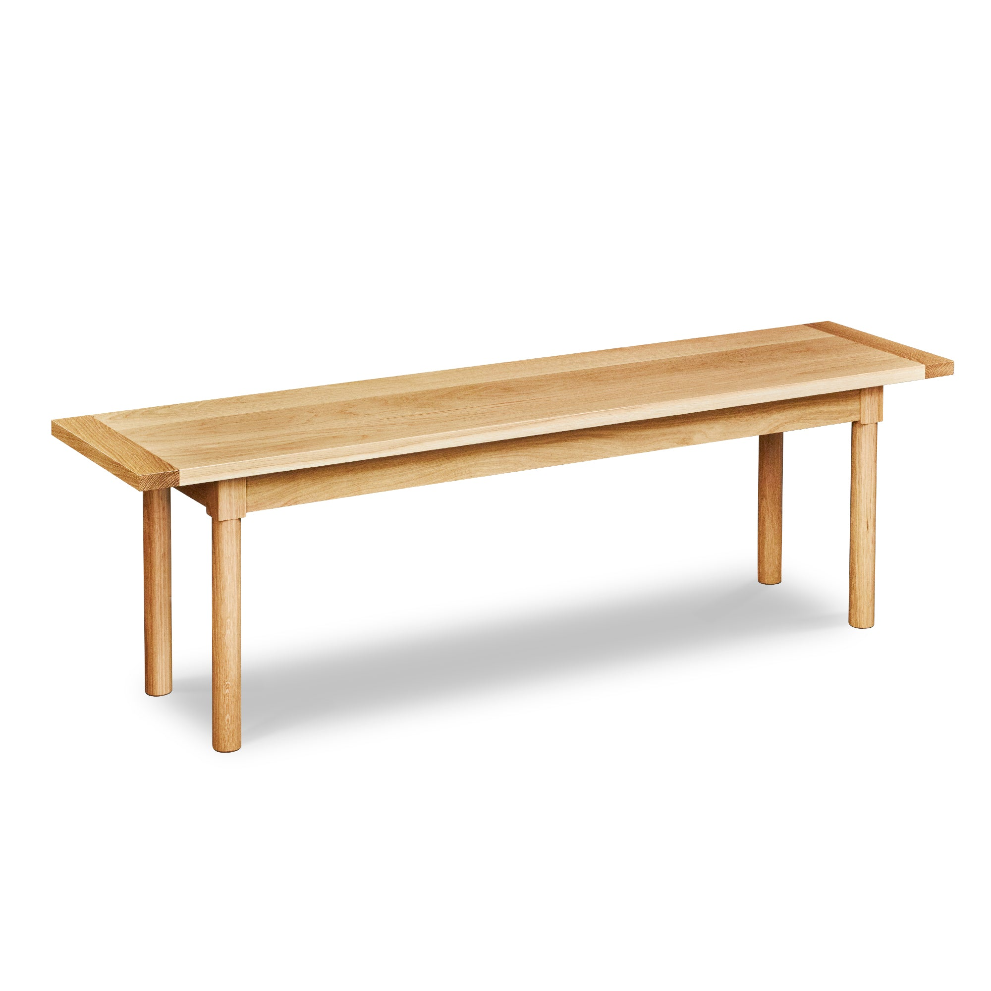 Modern Revelry bench with straight turned legs and breadboard ends, built in solid white oak