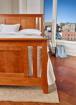 Modern bedroom with solid cherry wood Bangor bed