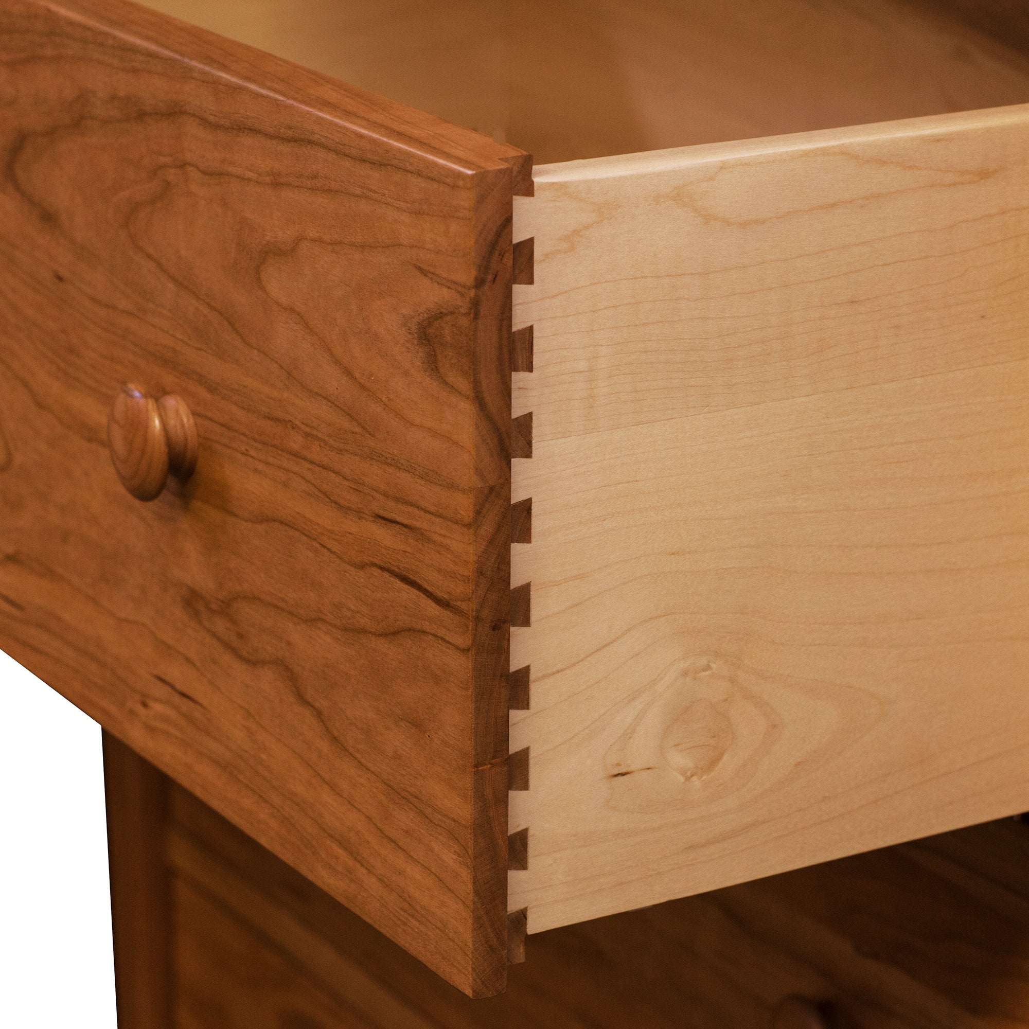 Open drawer of solid cherry Bethel Dresser showing dovetail joinery