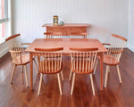 Clean dining room with Shaker sideboard, Bass Harbor Table and six Windsor style chairs, all made of cherry wood