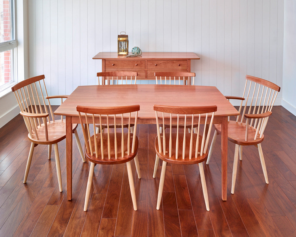 Nautical themed dining room with cherry wood Shaker inspired table, chairs and sideboard