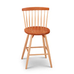 Cherry and maple counter stool with spindle back, from Maine's Chilton Furniture Co.