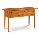 Shaker sideboard with four wide drawers and tapered legs, made of cherry wood from Maine's Chilton Furniture Co.