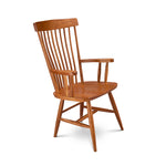 Solid cherry Waterford arm chair with round spindles on back and rounded crest