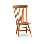 Solid cherry Waterford side chair with round spindles on back and rounded crest
