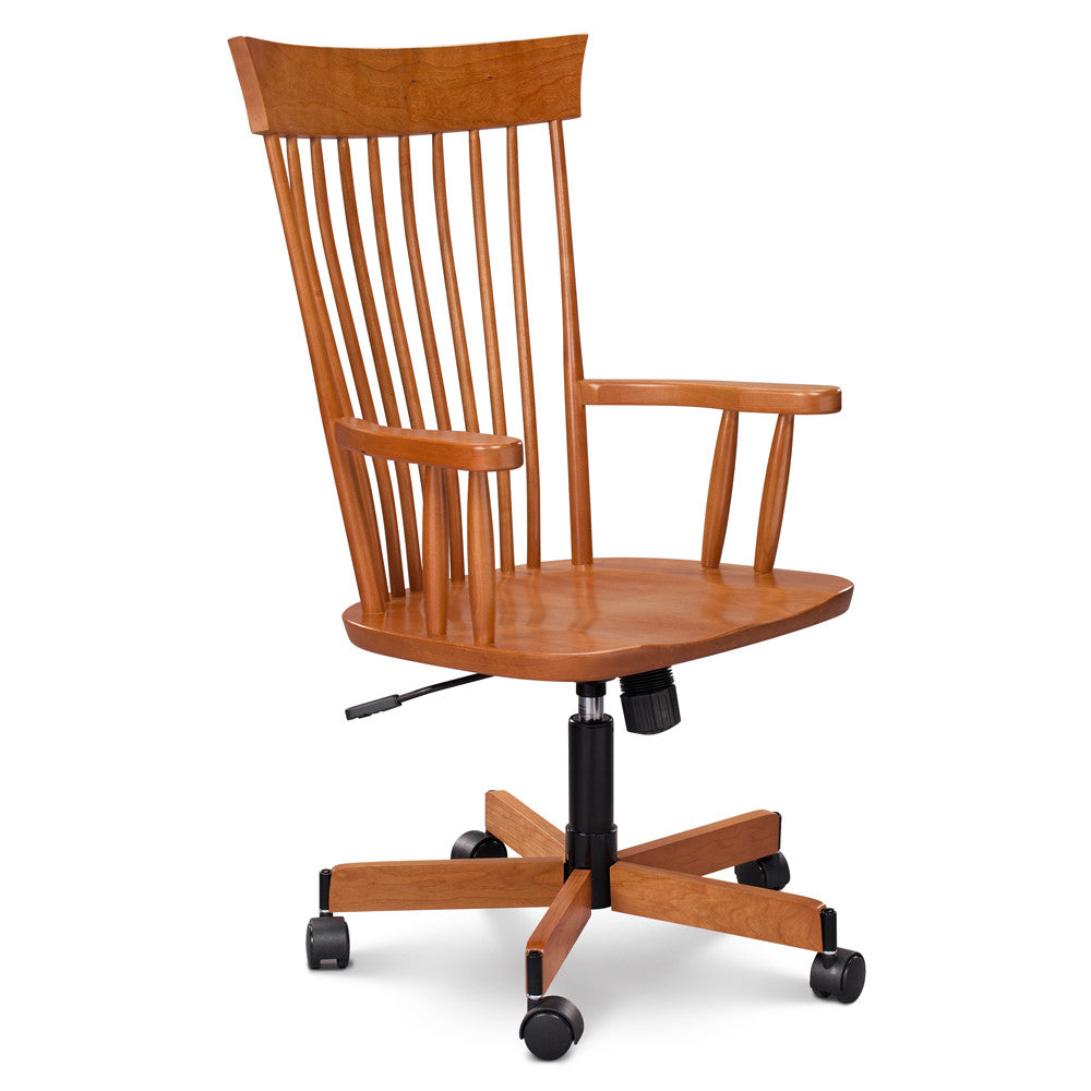Rolling desk chair in cherry with spindle back and arms and pointed crest