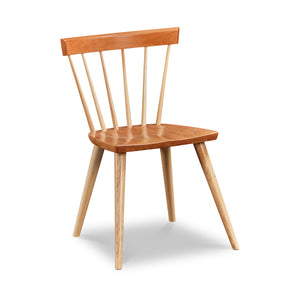 Modern Windsor inspired spindle chair with curved back in cherry and ash