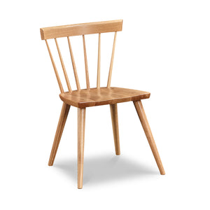 Modern Windsor inspired spindle chair with curved back in white oak