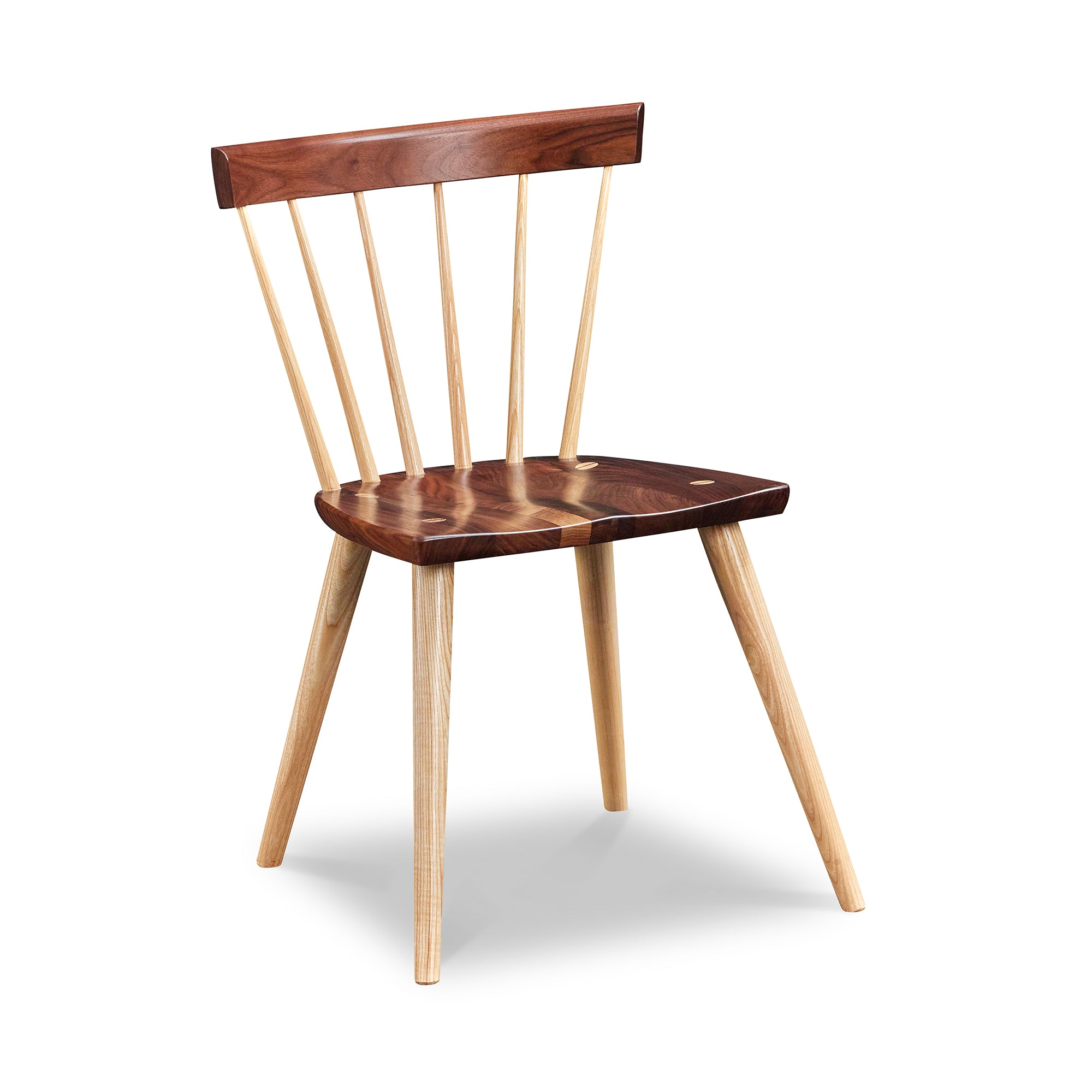 Modern Windsor inspired spindle chair with curved back in walnut and ash