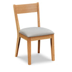 Modern Scandinavian style solid wood dining chair, in white oak with grey cushion, from Maine's Chilton Furniture Co.