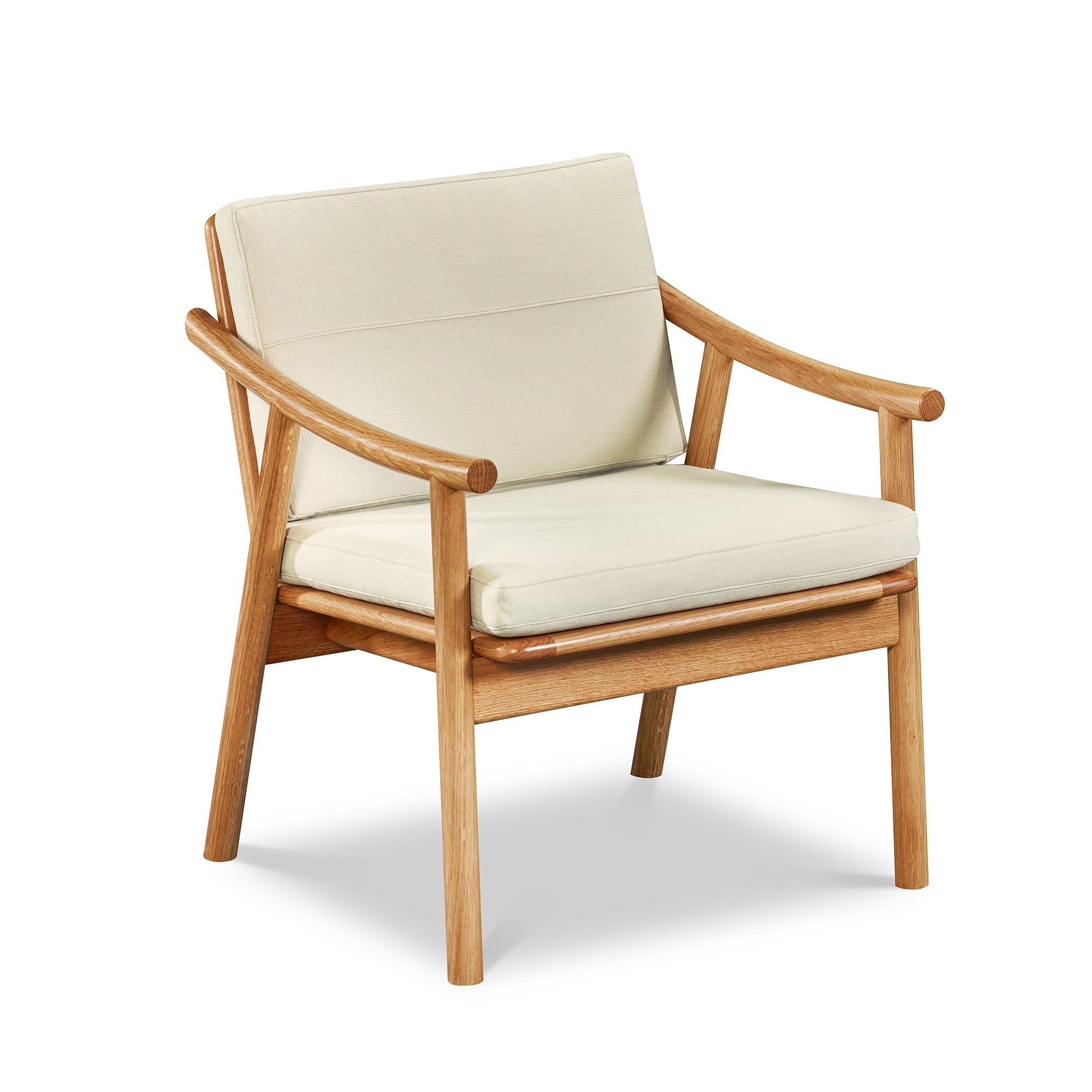 Solid white oak Scandinavian style lounge chair with Knoll fabric cushions in Buff, from Maine's Chilton Furniture Co.