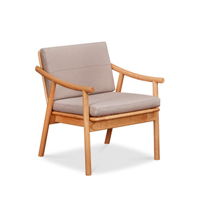 Solid cherry Scandinavian style lounge chair with Knoll fabric cushions in Putty, from Maine's Chilton Furniture Co.