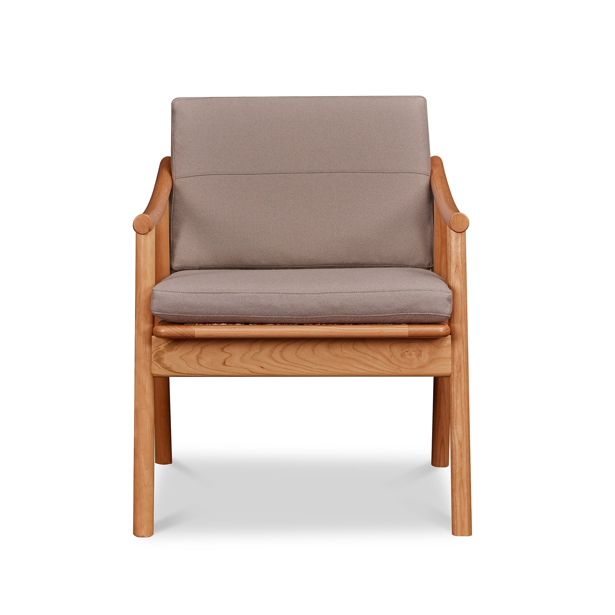 Front view of solid cherry Scandinavian style lounge chair with Knoll fabric cushions in Putty, from Maine's Chilton Furniture Co.