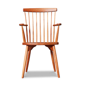 Classic spindle back chair arm chair with round tapered legs in solid cherry wood