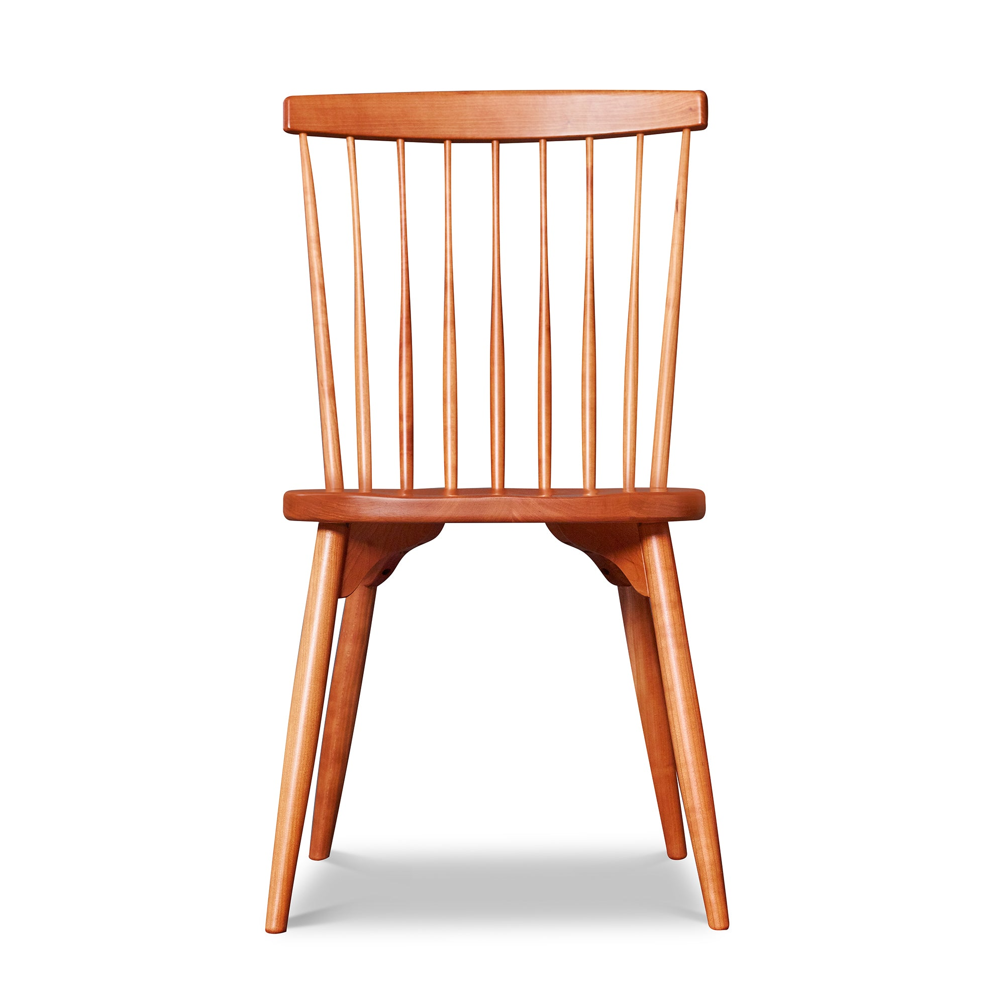 Classic spindle back chair with round tapered legs in solid cherry wood