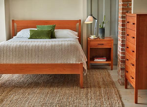 Bedroom with Shaker bed and Sunday River chest and nightstand in cherry, from Maine's Chilton Furniture Co.