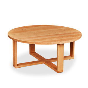 Solid cherry round Lokie Coffee table with minimalist deign and intersecting rectangular frame base