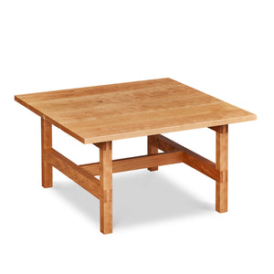 Modern square trestle-style coffee table with visible joinery in cherry, from Maine's Chilton Furniture Co.