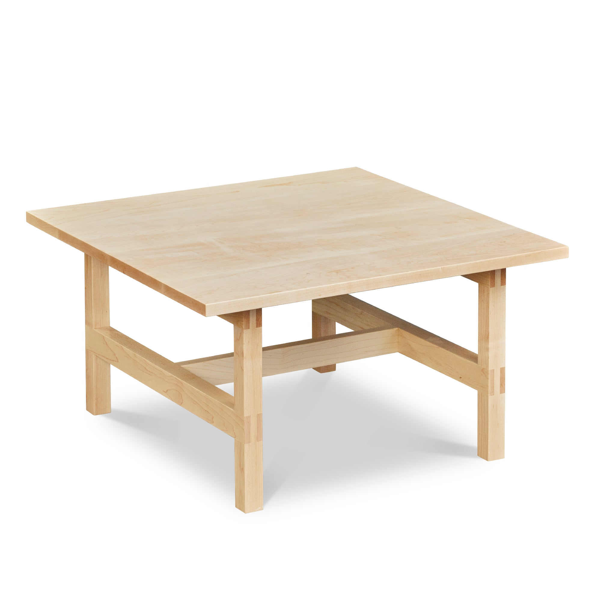 Modern square trestle-style coffee table with visible joinery in maple, from Maine's Chilton Furniture Co.