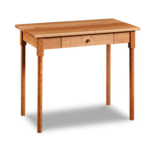 Small shaker inspired writing desk with one drawer and round legs in cherry wood