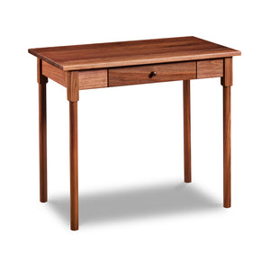 Small shaker inspired writing desk with one drawer and round legs in walnut wood