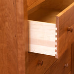 Open drawer of Shaker style Penobscot bedroom storage chest, in cherry wood
