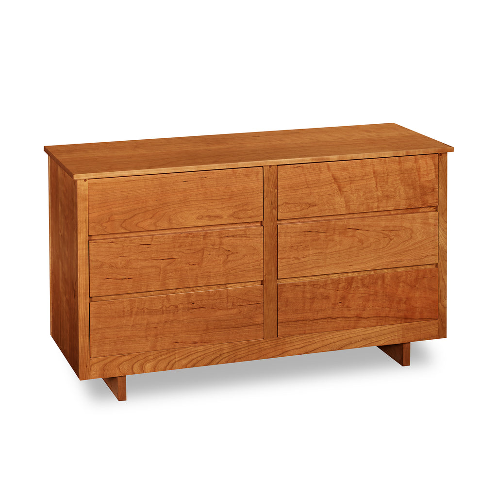 Chilton Furniture's Acadia collection six drawer cherry bedroom dresser with under drawer pulls and panel base