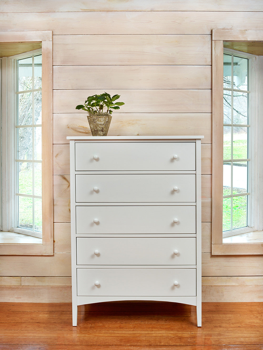 White Cottage Chest with five drawers in bright bedroom with ship lap walls
