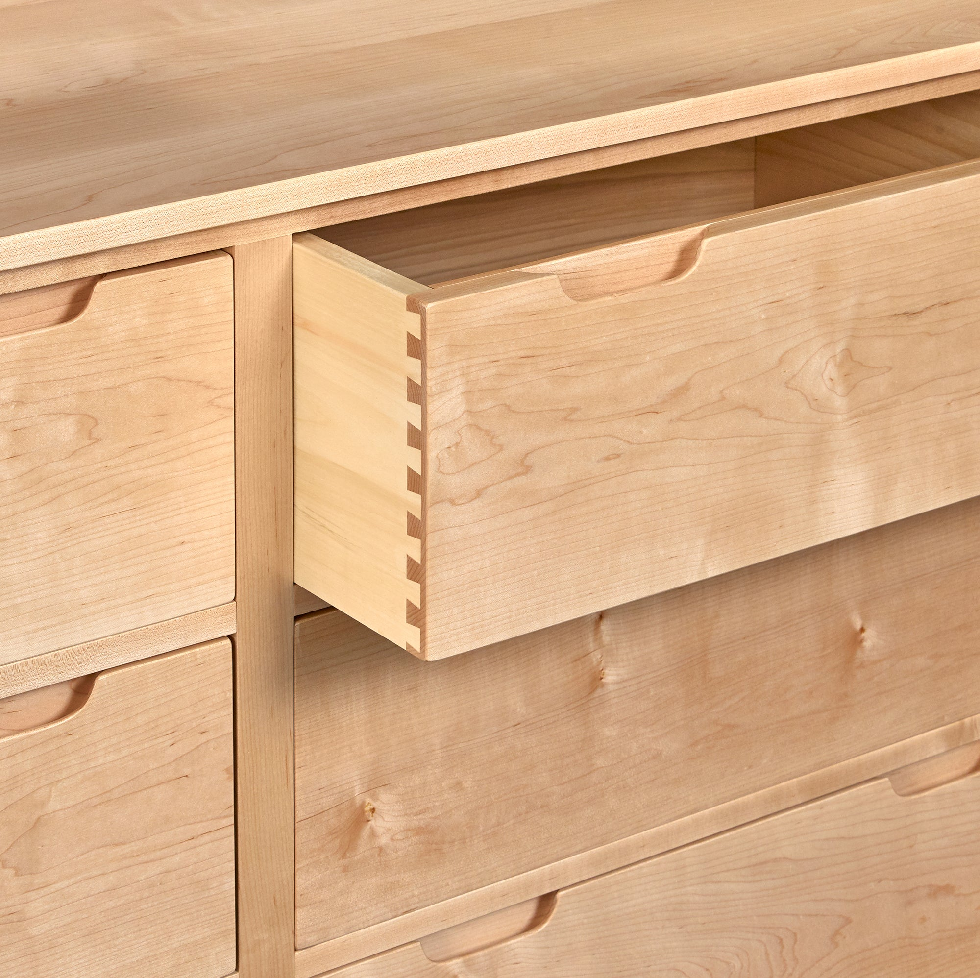 Open drawer of of maple Foundation Dresser